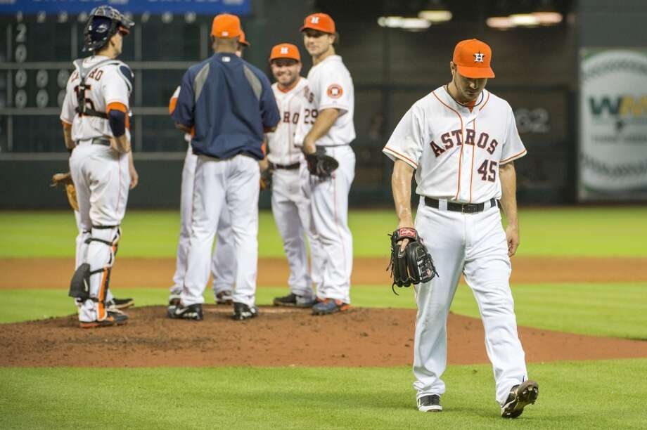 Astros starting pitcher Erik Bedard leaves the game during the seventh inning.