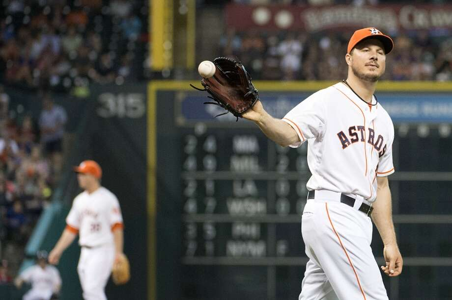 Astros starting pitcher Erik Bedard gets a new ball after giving up a run on a passed ball during the sixth inning.