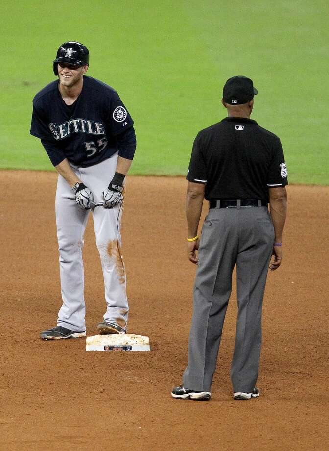 Michael Saunders reacts to his double, the first Mariners hit of the night.
