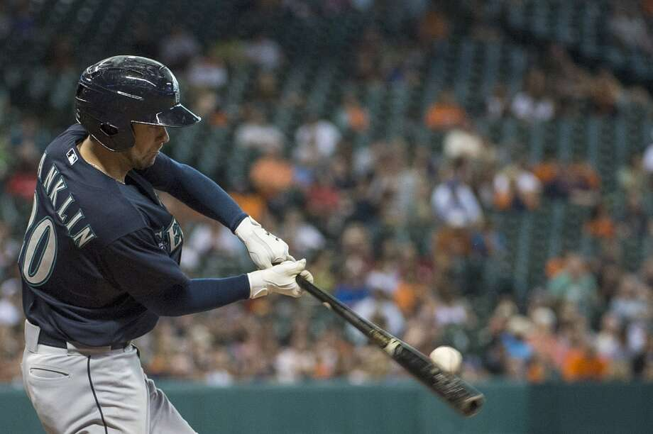 Mariners second baseman Nick Franklin drives in a run with a sacrifice fly during the sixth inning.
