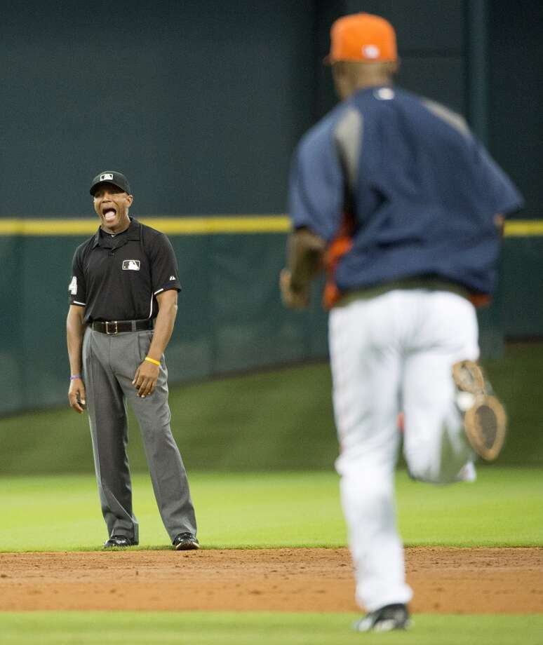 Astros manager Bo Porter races out to question a call by umpire CB Bucknor during the sixth inning.