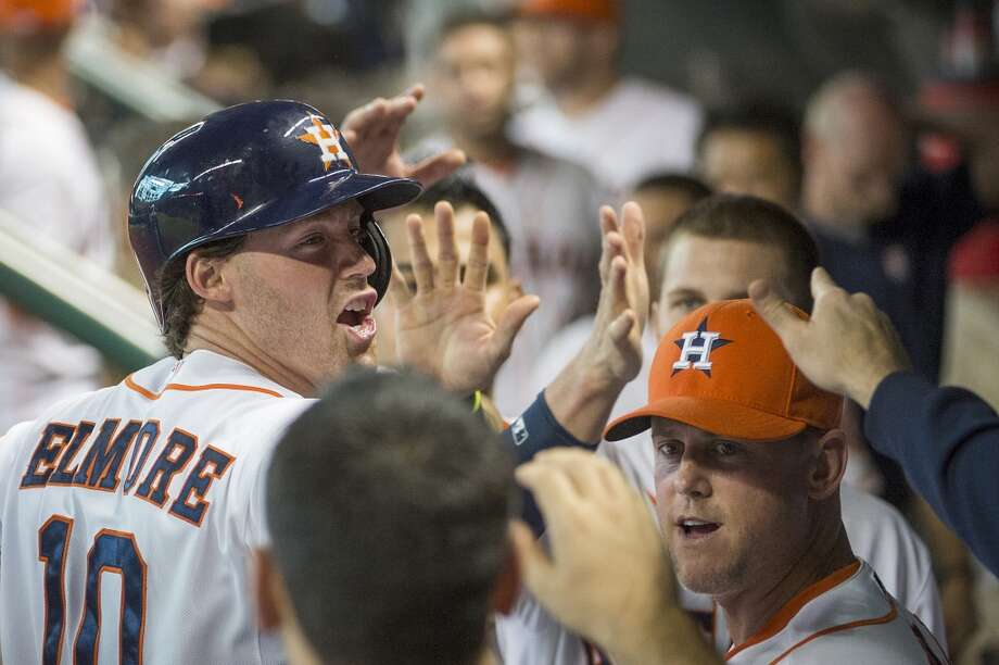 Astros shortstop Jake Elmore celebrates after scoring during the fifth inning.
