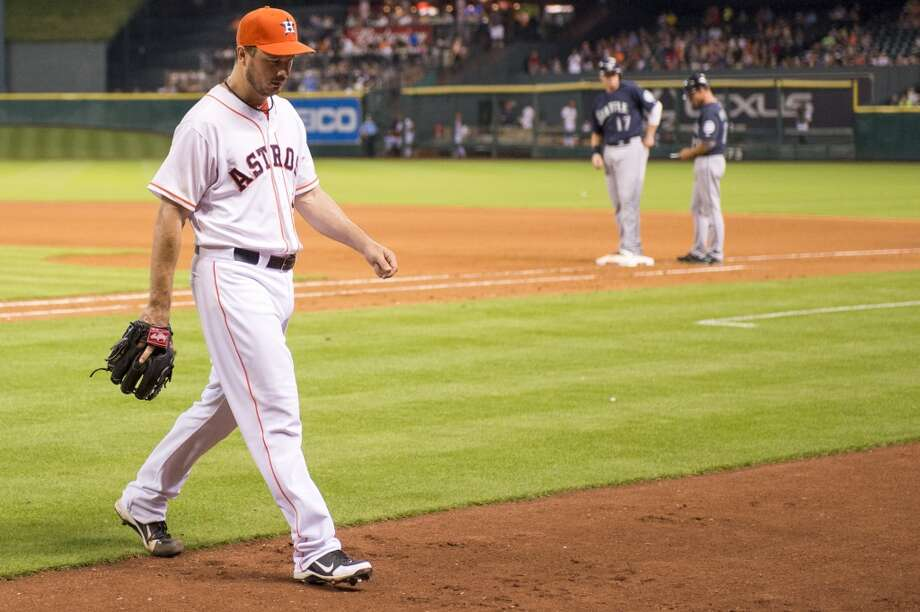 Astros starting pitcher Erik Bedard leaves the game during the seventh inning after giving up two runs, but no hits, against the Mariners.