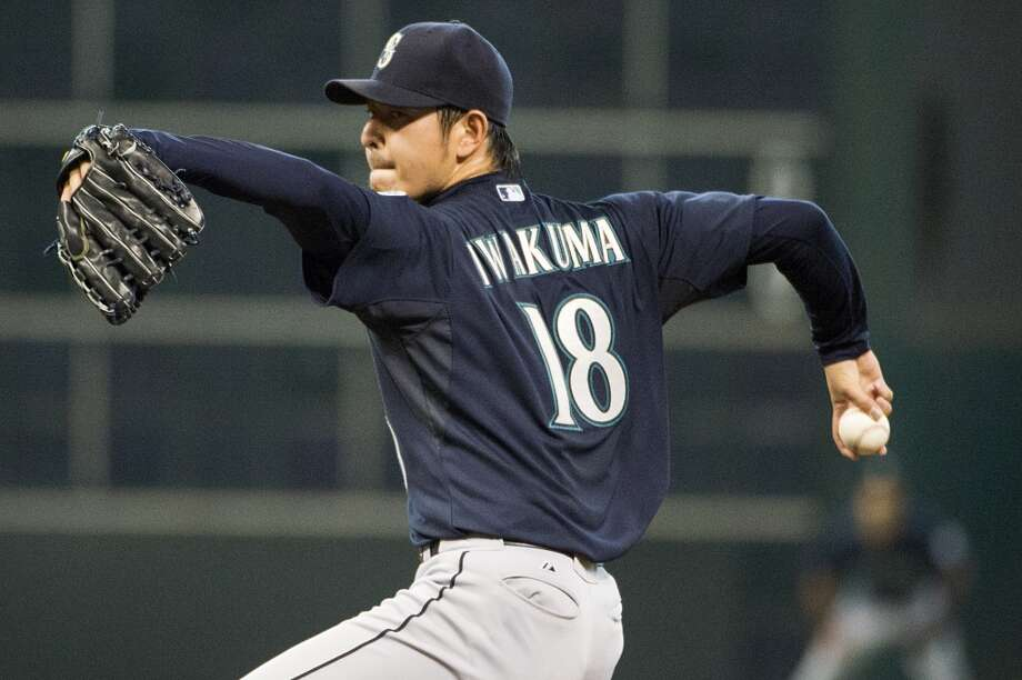 Mariners starting pitcher Hisashi Iwakuma pitches during the first inning.