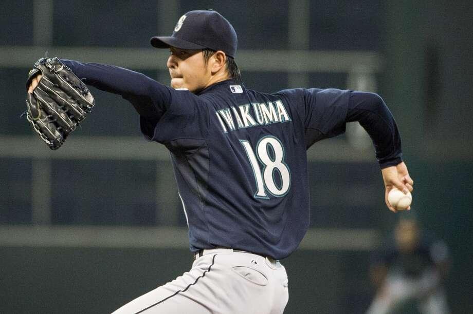 Mariners starting pitcher Hisashi Iwakuma pitches during the first inning.