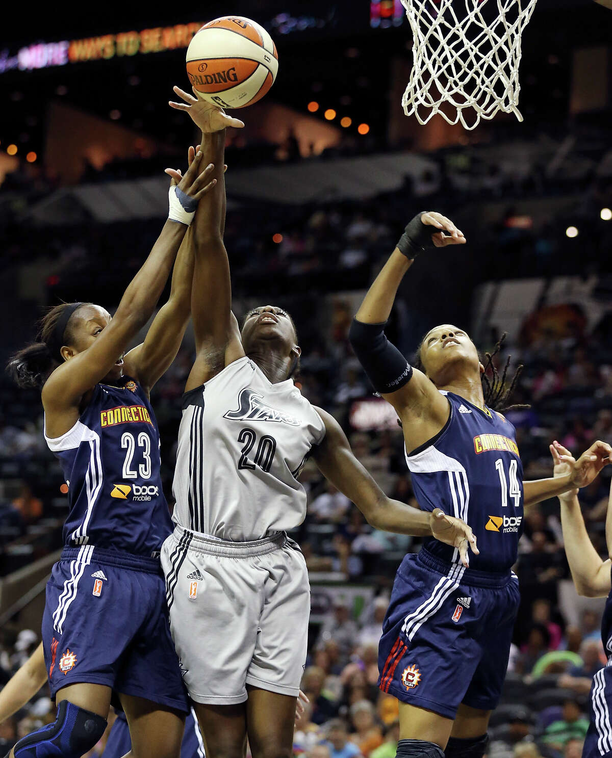 Silver Stars' Shameka Christon (center) grabs for a rebound between Sun's Allison Hightower (left) and Tan White during first half action Saturday, July 20, 2013, at the AT&T Center.