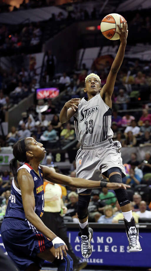 Silver Stars' Danielle Robinson shoots around Sun's Allison Hightower during first half action Saturday, July 20, 2013, at the AT&T Center. Photo: Edward A. Ornelas, San Antonio Express-News / © 2012 San Antonio Express-News