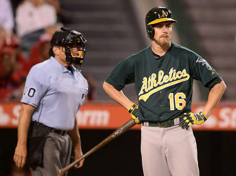 ANAHEIM, CA - JULY 20:  Josh Reddick #16 of the Oakland Athletics reacts to his called strikeout in front of home plate umpire Tom Hallion during the eighth inning against the Los Angeles Angels  at Angel Stadium of Anaheim on July 20, 2013 in Anaheim, California.  (Photo by Harry How/Getty Images) Photo: Harry How, Getty Images