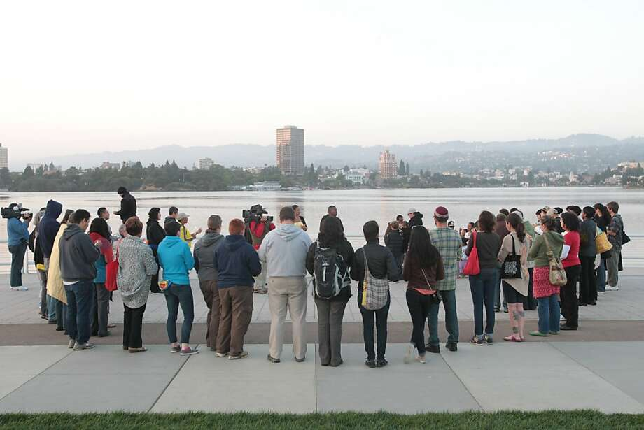 A candlelight vigil for the late Trayvon Martin was held at Oakland's Lake Merritt on Saturday. Photo: Mathew Sumner, Special To The Chronicle