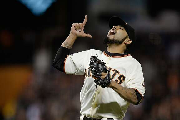 SAN FRANCISCO, CA - JULY 20:  Sergio Romo #54 of the San Francisco Giants celebrates defeating the Arizona Diamondbacks 4-3 at AT&T Park on July 20, 2013 in San Francisco, California.  (Photo by Thearon W. Henderson/Getty Images)