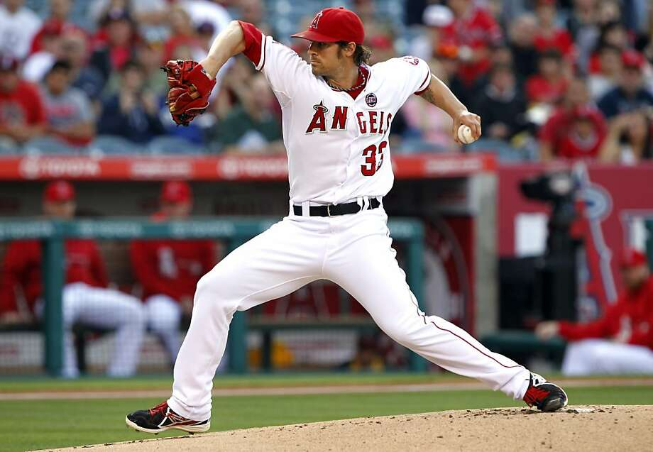 Los Angeles Angels starting pitcher C.J. Wilson delivers against the Oakland Athletics in the first inning during a baseball game Saturday, July 20, 2013 in Anaheim, Calif. (AP Photo/Alex Gallardo) Photo: Alex Gallardo, Associated Press
