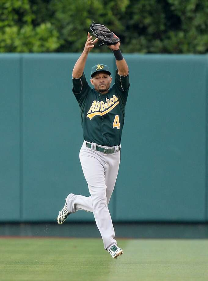 ANAHEIM, CA - JULY 20:  Coco Crisp #4 of the Oakland Athletics makes a running catch for an out of Erick Aybar #2 of the Los Angeles Angels to end the second inning at Angel Stadium of Anaheim on July 20, 2013 in Anaheim, California.  (Photo by Harry How/Getty Images) Photo: Harry How, Getty Images