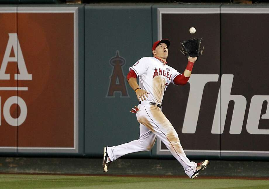 Los Angeles Angels center fielder Mike Trout catches a fly ball hit by Oakland Athletics' Grant Green (not pictured) in the eighth inning during a baseball game Saturday, July 20, 2013 in Anaheim, Calif. (AP Photo/Alex Gallardo) Photo: Alex Gallardo, Associated Press