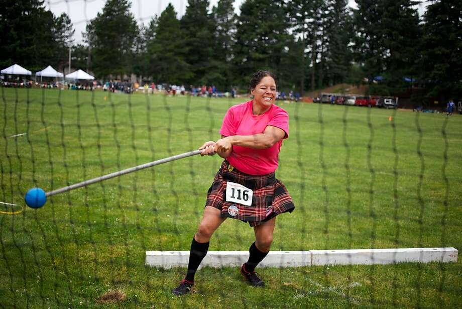 Ivory Carr, competes in the women's elite heavy hammer toss at the Highland Games at Mt. Hood Community College in Gresham, Ore., Saturday, July 20, 2013. (AP Photo/The Oregonian, Brittany Greeson)  Photo: Brittany Greeson, Associated Press