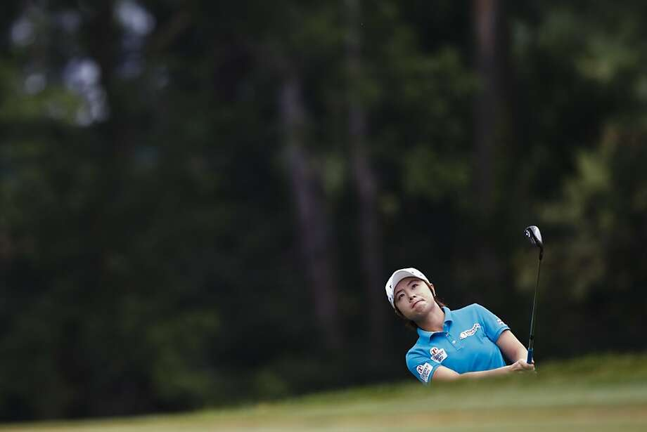 Eun-Hee Ji, of South Korea, takes a chip shot on the first hole during the third round of the Marathon Classic golf tournament at Highland Meadows Golf Club in Sylvania, Ohio, Saturday, July 20, 2013. (AP Photo/Rick Osentoski) Photo: Rick Osentoski, Associated Press