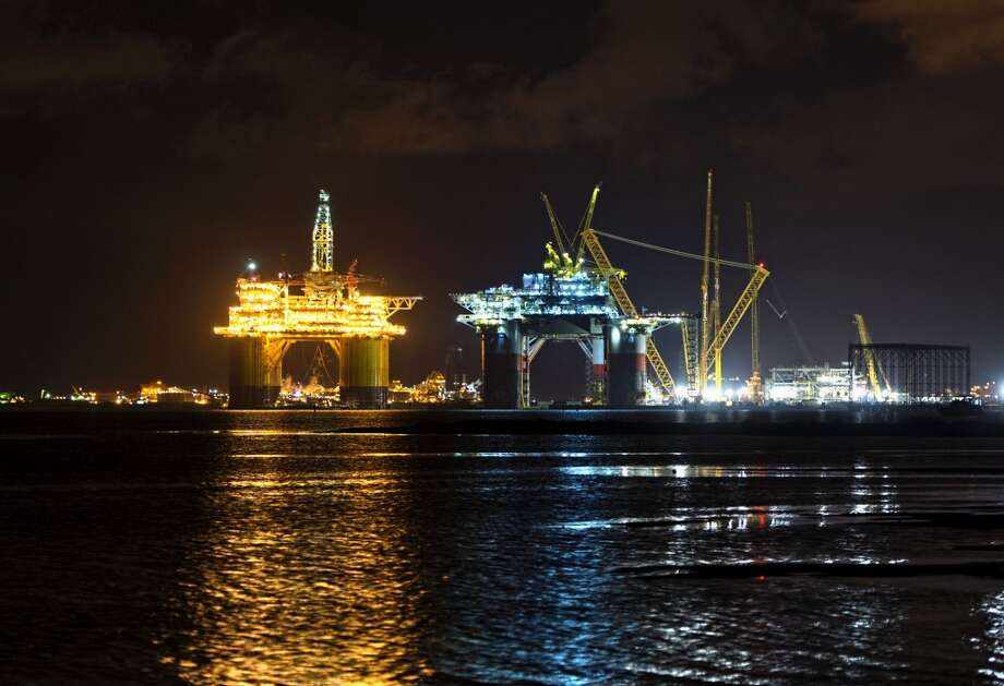The Royal Dutch Shell Plc Olympus tension leg platform (TLP) is seen at night as it sets sail from Kiewit Offshore Services in Ingleside, Texas, U.S., on Saturday, July 13, 2013. Olympus, Shell's biggest constructed tension leg platform, started the ten day, 425-mile voyage to Mars B Field in the Gulf of Mexico on July 13. Photographer: Eddie Seal/Bloomberg Photo: Eddie Seal, Bloomberg