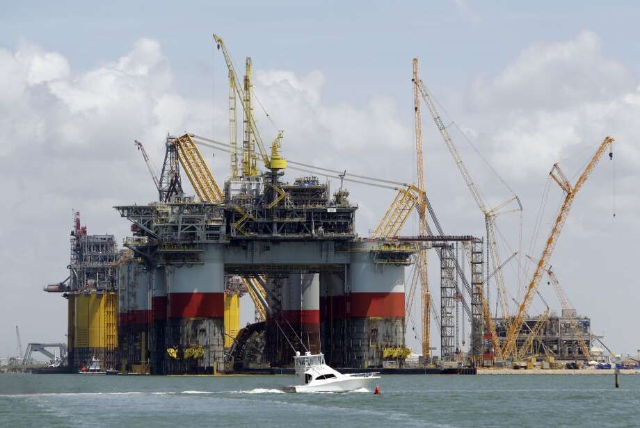A boat passes by Chervon's semi-submersible platform named Jack / St Malo shown under construction at Kiewit Offshore Services, 2440 Kiewit Road, Thursday, July 11, 2013, in Ingleside. Behind the Jack / St Malo is Chevron's tension leg platform named Big Foot, Anadarko Petroleum Corporation's Lucius truss spar and Shell's tension leg platform named Olympus. ( Melissa Phillip / Houston Chronicle ) Photo: Melissa Phillip, Houston Chronicle