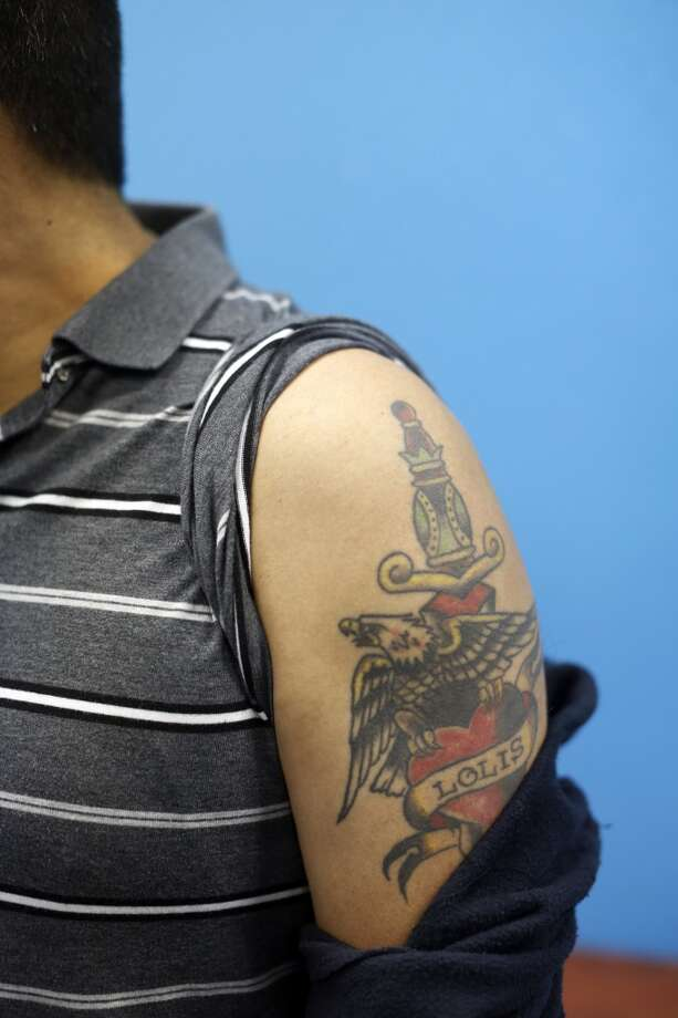 Juan Velasquez sits in the waiting from before a tattoo removal treatment at the San Pablo Economic Development Corp. program Removing Barriers in San Pablo, Calif. on July 19, 2013.