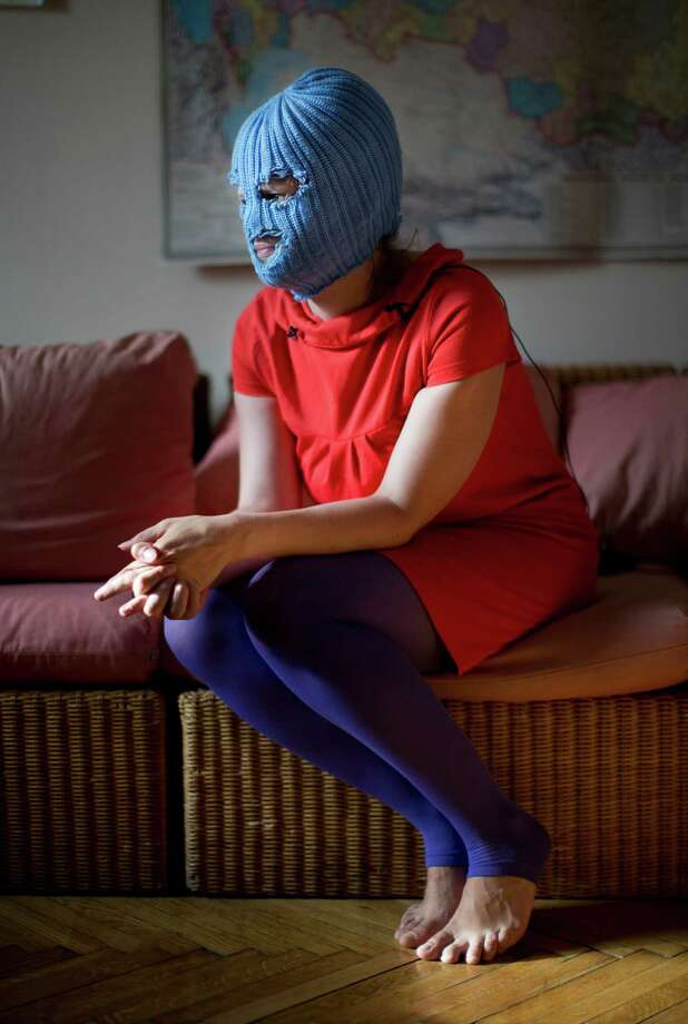 A member of Russian punk band Pussy Riot, who gave only her stage name  of Grelka, wears a blue balaclava as speaks to the media in Moscow,  Tuesday, July 16, 2013. Russian provocateurs Pussy Riot are back in  action, releasing their first music video since three members went to  prison last year for a prank denouncing Vladimir Putin. Photo: AP