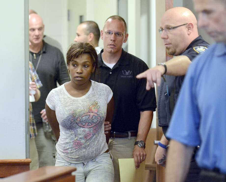 Audrea Gause, 26, of Troy, N.Y., is led into court in Troy, N.Y. on Friday, July 19, 2013 to be arraigned on a Massachusetts fugitive warrant for defrauding the One Fund Boston of $480,000. Authorities said she used fake hospital records to pose as a Boston Marathon bombing victim with a brain injury and fraudulently collected nearly half a million dollars from the fund for victims, Massachusetts authorities said Friday. Photo: AP