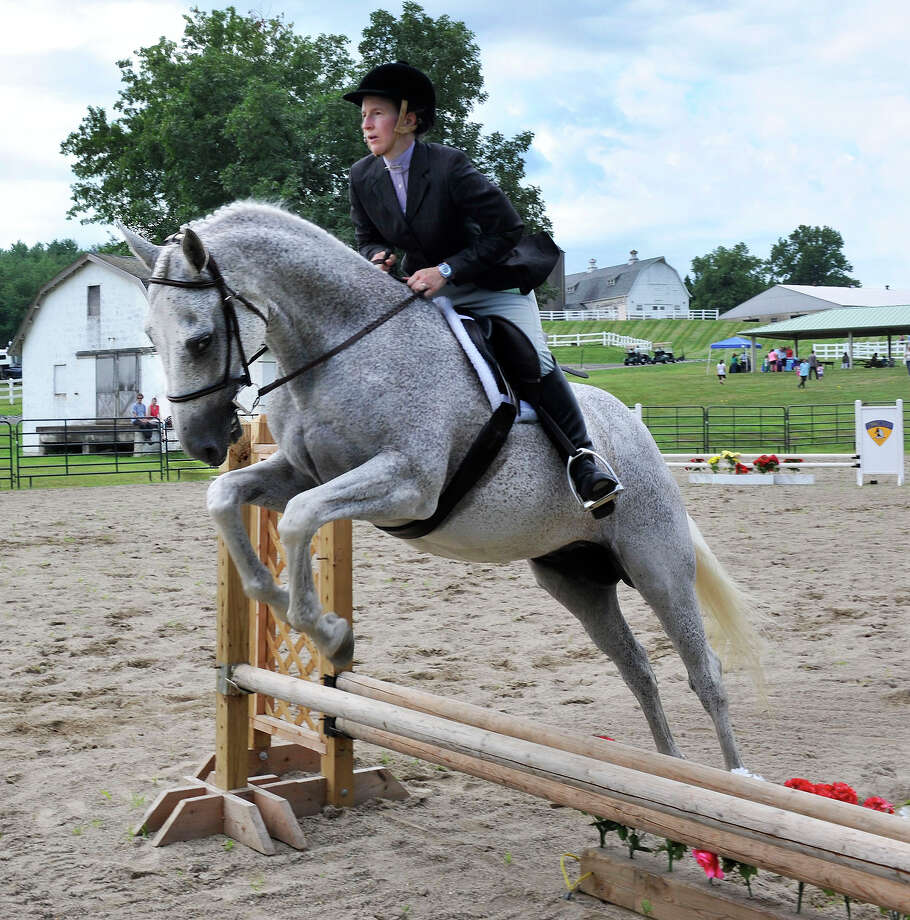 Catherine Bracco jumps with Silver Escape in the Second Company Governor's Horse Guard Annual Horse Show in Newtown, Conn. Sunday, July 21, 2013. Photo: Michael Duffy / The News-Times