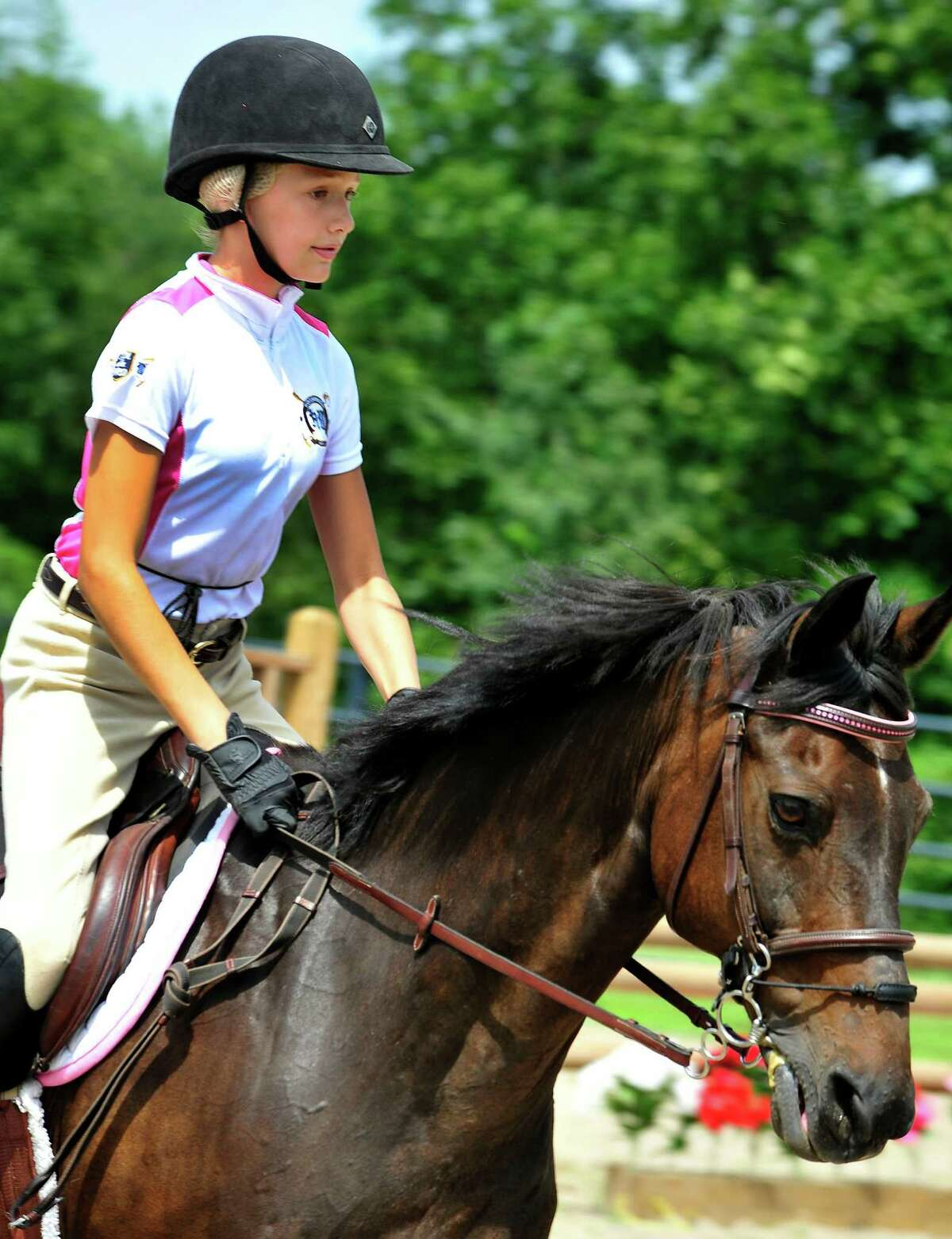 Mia Matuschkowitz-Mannis, 11, rides Just Do It, in t he Second Company Governor's Horse Guard Annual Horse Show in Newtown, Conn. Sunday, July 21, 2013.