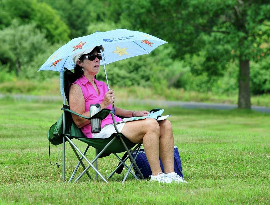 Patti McCusker, of Newtown, watches the Second Company Governor's Horse Guard Annual Horse Show in Newtown, Conn. Sunday, July 21, 2013. Photo: Michael Duffy / The News-Times