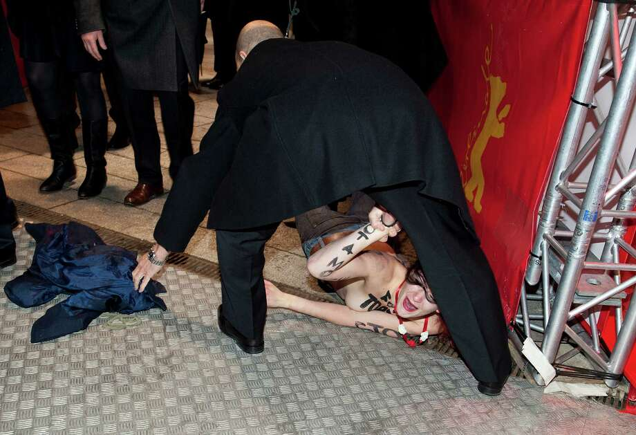 Activist of the Ukrainian women rights group 'Femen' is arrested by security after protesting half naked against genital mutilation  close to the red carpet at the opening of the 63rd Berlinale International Film Festival Berlinale Internation on February 7, 2013 in Berlin, Germany.  Photo: Target Presse Agentur Gmbh, Getty Images / 2013 Target Presse Agentur Gmbh