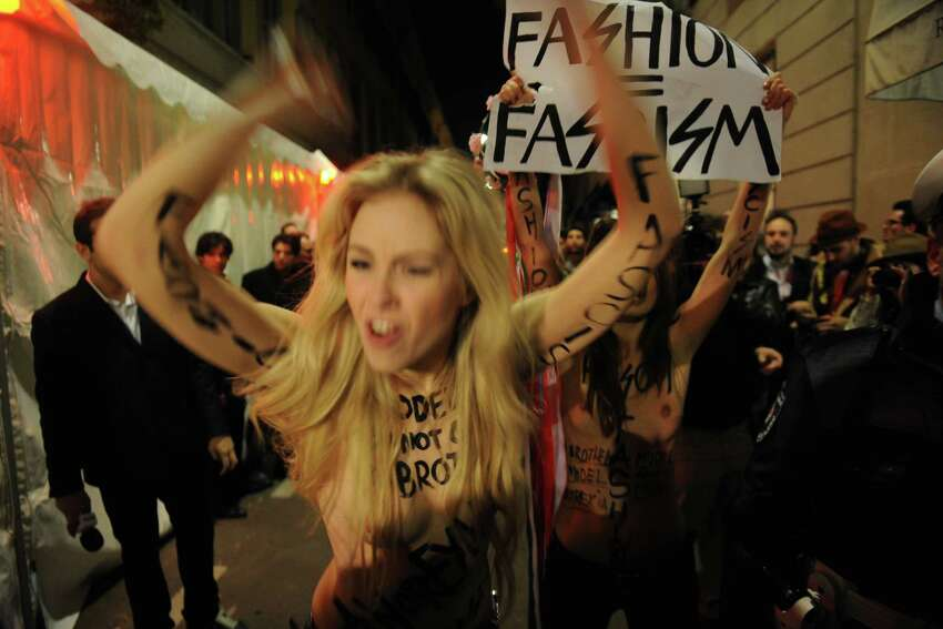 Activists with the feminist movement FEMEN protest during the Milan Womenswear Fashion Week on February 24, 2012 in Milan, Italy. FEMEN is a Kiev-based Ukrainian social movement and provocative women's movement in Ukraine, founded in 2008 by Anna Hutsol
