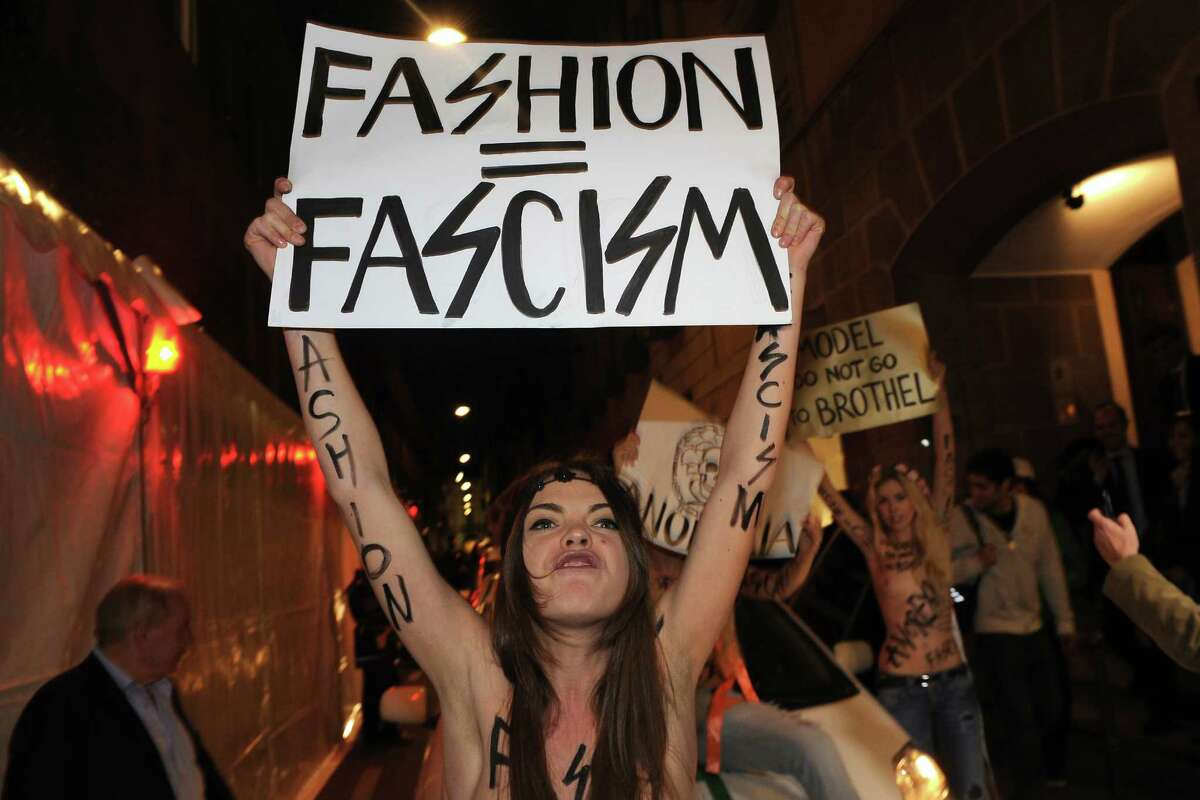 An activist with the feminist movement FEMEN protests during the Milan Womenswear Fashion Week on February 24, 2012 in Milan, Italy. FEMEN is a Kiev-based Ukrainian social movement and provocative women's movement in Ukraine, founded in 2008 by Anna Hutsol