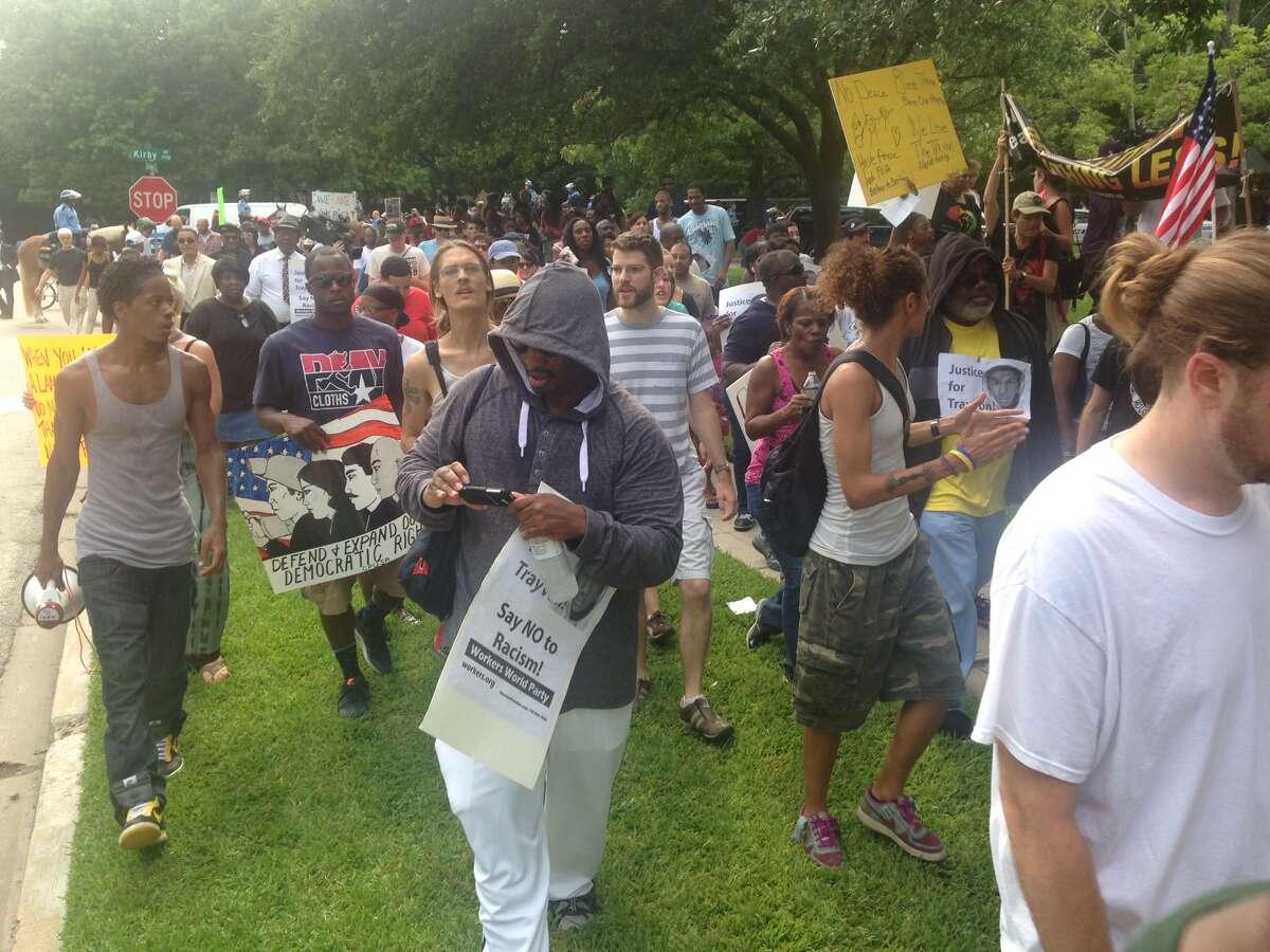 Protestors walk River Oaks.