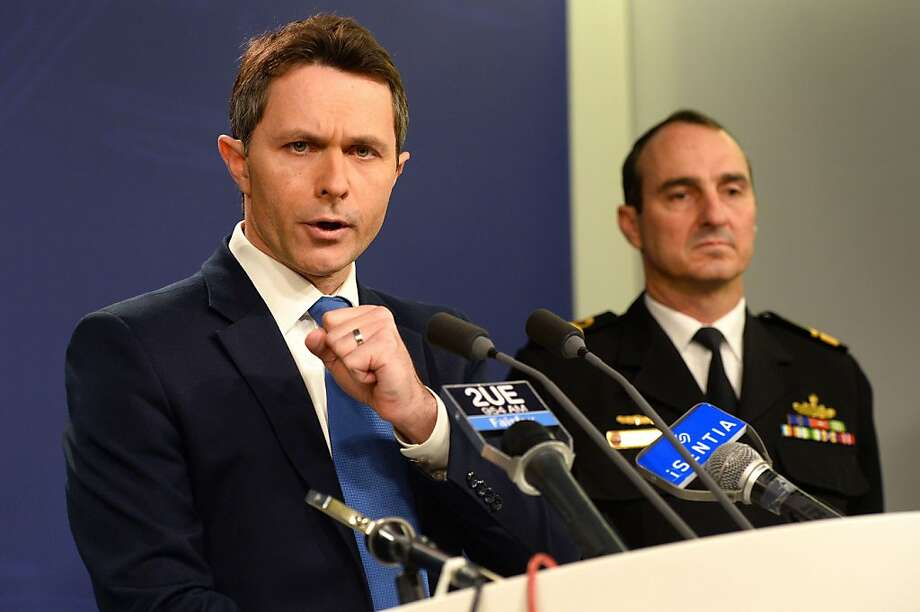 "Home Affairs Minister Jason Clare (L) speaks to the media with Commander of Border Protection Command, Rear Admiral David Johnston, Royal Australian Navy (R), during a press conference in Sydney on July 17, 2013.  Asylum-seekers drowning on the treacherous boat journey to Australia presented a ""god-awful"" problem, Home Affairs Minister Jason Clare said after four more died during a dramatic sea rescue.  Authorities pulled 144 people from the surging waters off the Indian Ocean territory of Christmas Island late on Tuesday, but they also recovered four bodies after the ship carrying an estimated 150 people capsized and sank.  AFP PHOTO/William WESTWILLIAM WEST/AFP/Getty Images Photo: William West, AFP/Getty Images"