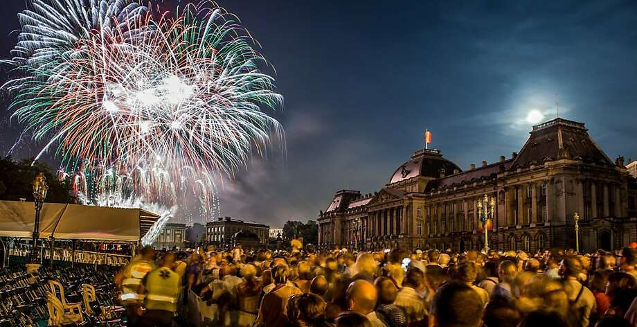 A day of celebrating King Philippe ends with fireworks over the Royal Palace in Brussels. Photo: Geert Vanden Wijngaert, Associated Press