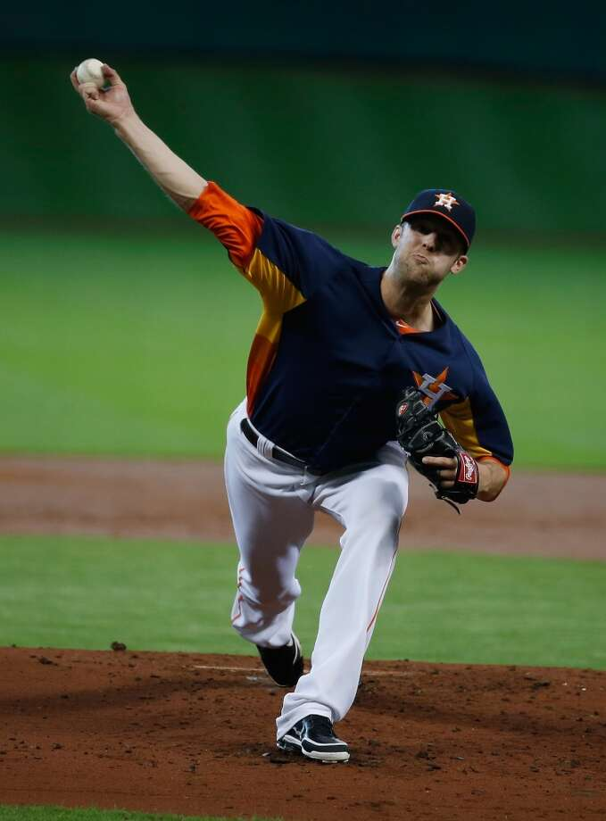 Astros pitcher Jordan Lyles delivers a throw to the Mariners.