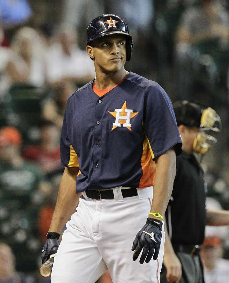 Justin Maxwell of the Astros reacts after striking out against the Mariners.