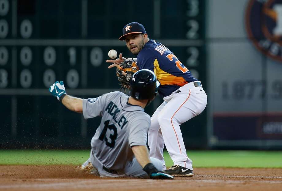 Astros second baseman Jose Altuve tries to make a play at second base.