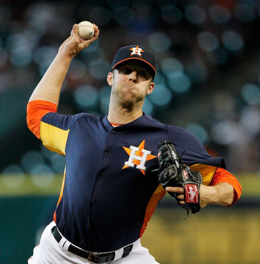 Astros pitcher Jordan Lyles makes a throw to the Mariners.