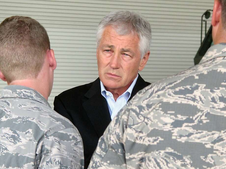 Secretary of Defense Chuck Hagel talks with Air Force personnel at South Carolina's Joint Base Charleston as part of a tour of Southern military bases. Photo: Bruce Smith, Associated Press