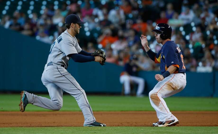 Jake Elmore of the Astros gets caught in a rundown against the Mariners.