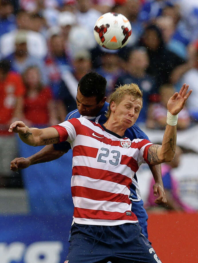 United States' Brek Shea (23) heads a ball in front of El Salvador's Xavier Garcia Orellana during the second half in the quarterfinals of the CONCACAF Gold Cup soccer tournament on Sunday, July 21, 2013, in Baltimore. The United States won 5-1. (AP Photo/Patrick Semansky) Photo: Patrick Semansky, Associated Press / AP