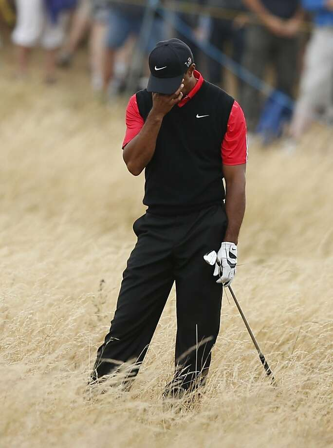 Tiger Woods reacts after playing a shot on the 11th hole on the final day of the British Open. He finished tied for sixth. Photo: Matt Dunham, Associated Press