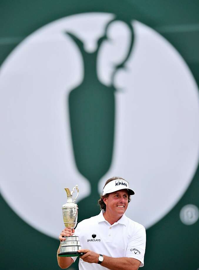 Phil Mickelson holds the claret jug after winning the British Open at Muirfield in Scotland. Mickelson finished the tournament with a superb final round of 66. Photo: Glyn Kirk, AFP/Getty Images