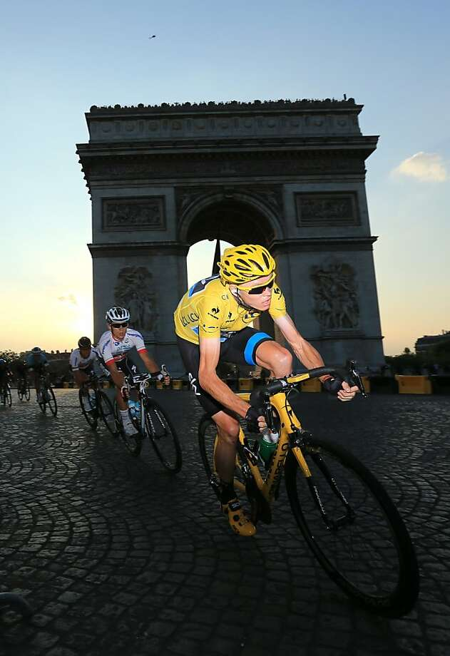 Froome drives toward the finish at the Arc d'Triomphe, becoming the second British winner in two years. Photo: Doug Pensinger, Getty Images