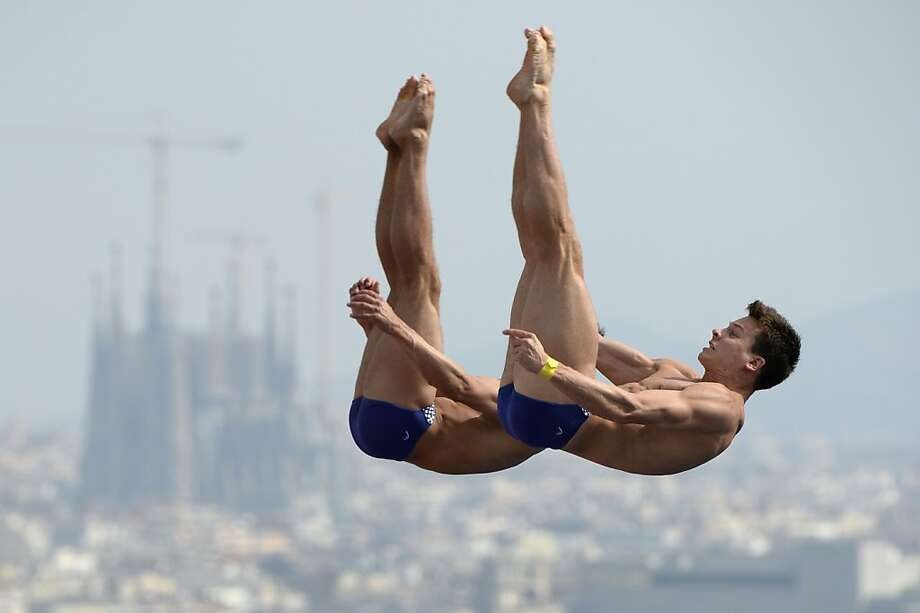 Germany's Klein Sascha and Patrick Hausding compete in the men's 10-metre synchro platform preliminary diving event in the FINA World Championships at the Piscina Municipal de Montjuic in Barcelona on July 21, 2013. Photo: Lluis Gene, AFP/Getty Images