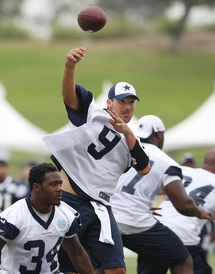 Quarterback Tony Romo (09) makes a throw at the Dallas Cowboys training camp on Sunday, July 21, 2013 in Oxnard. Photo: Kin Man Hui, San Antonio Express-News / ©2013 San Antonio Express-News