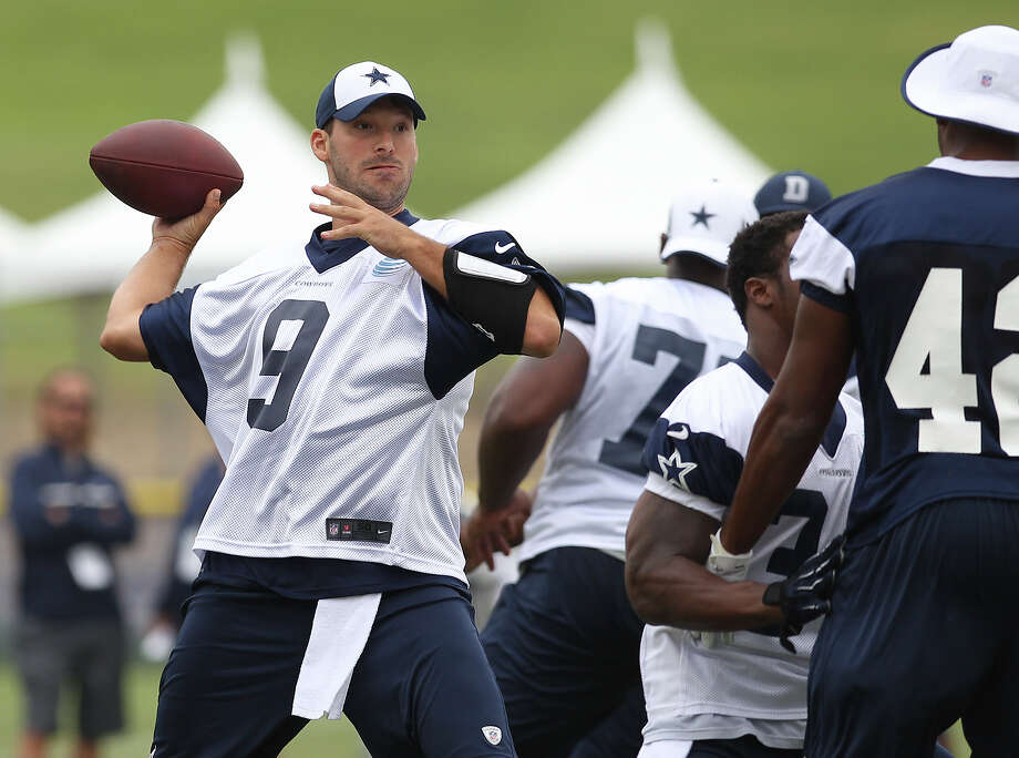 Quarterback Tony Romo (09) rears back for a pass at the Dallas Cowboys training camp on Sunday, July 21, 2013 in Oxnard. Photo: Kin Man Hui, San Antonio Express-News / ©2013 San Antonio Express-News