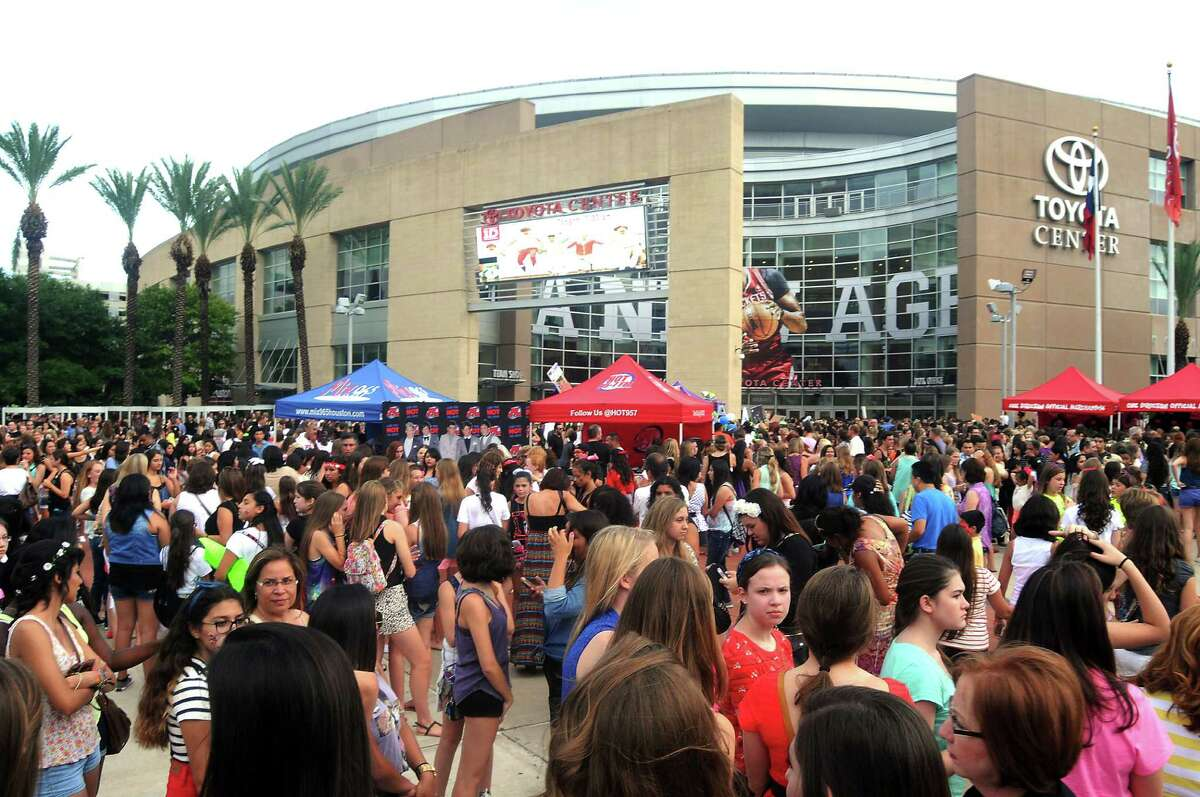 Fans await the sold-out One Direction concert outside the Toyota Center Sunday July 21, 2013.(Dave Rossman photo)