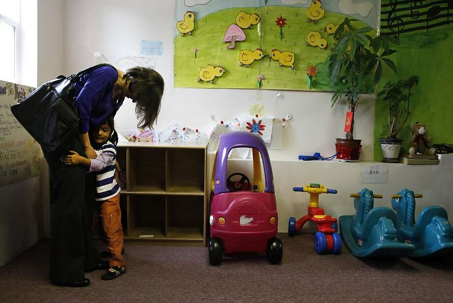 """Meg Byrne picks up her daughter, Jyotsna Byrne, 4, from day care. """"Both my husband and I would like more flexibility in our work,"""" Meg Byrne says. """"The United States is not very supportive of working families."""" Photo: Katie Meek, The Chronicle"""