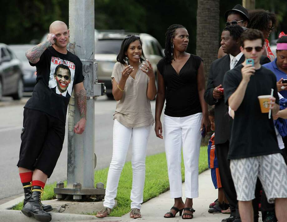 Houston community activist Quanell X lead group marchers wait at an intersection as protestors from the G. Zimmerman River Oaks Stand Your Ground group hold a counter demonstration to a march in the River Oaks community to protest a Florida jury's acquittal of George Zimmerman in the shooting death of Trayvon Martin. Sunday, July 21, 2013, in Houston. Photo: James Nielsen, Houston Chronicle / © 2013  Houston Chronicle