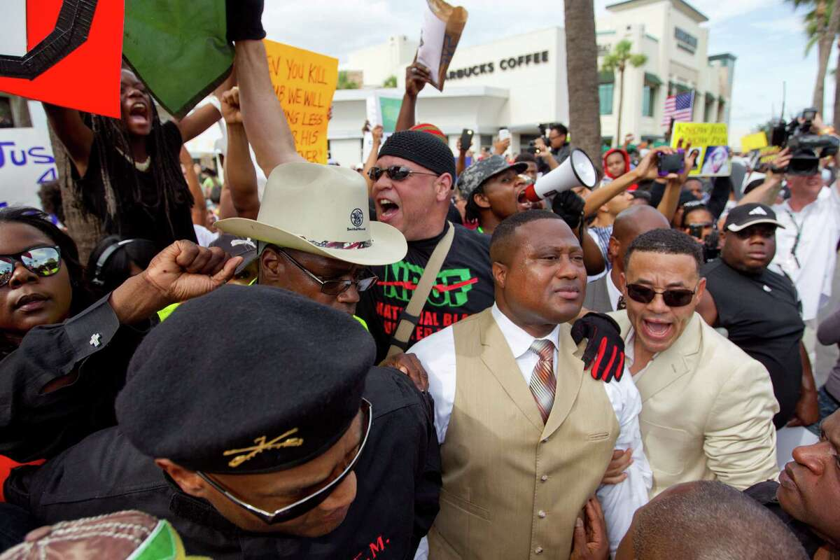Led by activist Quanell X nearly 1,000 people protested against a Florida jury's acquittal of George Zimmerman in the shooting death of Trayvon Martin ih the River Oaks community on the corner of W. Gray and Shepherd Streets Sunday, July 21, 2013, in Houston.